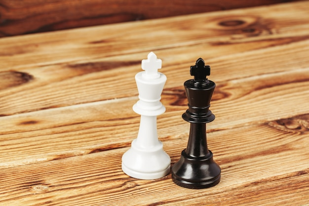 Chess figures on wooden background