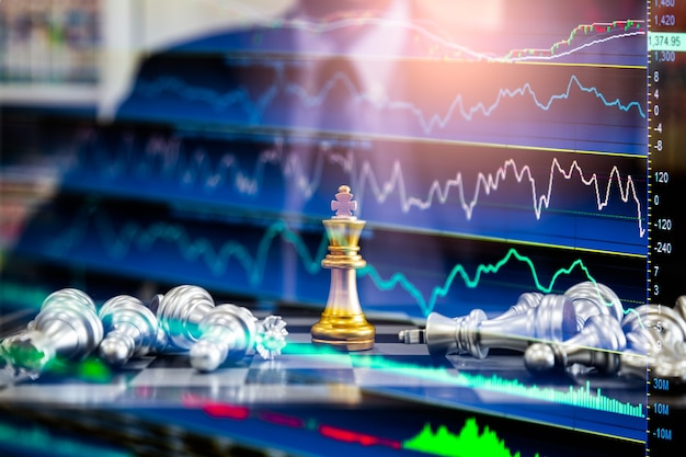 Chess game on chess board behind business man background. business concept to present financial information and marketing strategy analysis. investment target in global economy and digital commercial.