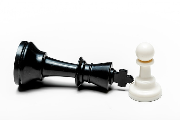 Chess game or chess pieces on white surface