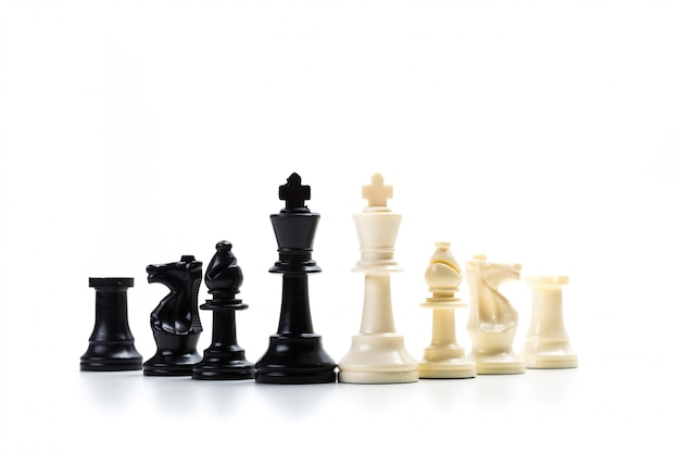 Chess game or chess pieces on white