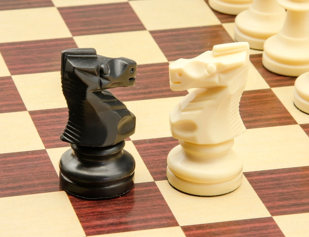 Chess game pieces on board
