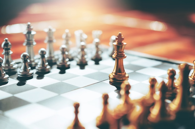 Chess game of successful business leader concept