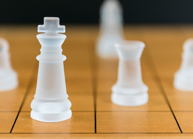 Chess glass on a wood chessboard