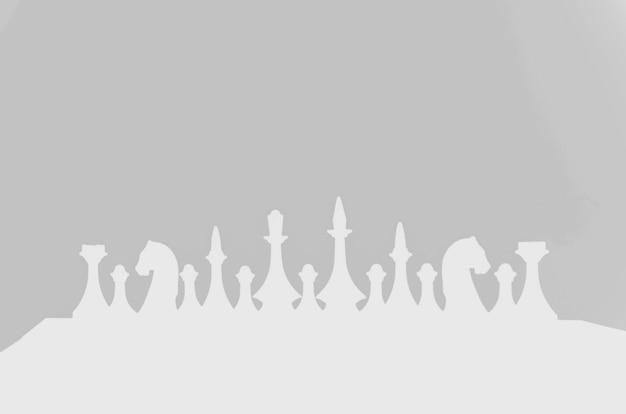 灰色の背景にチェス。趣味のコンセプト。