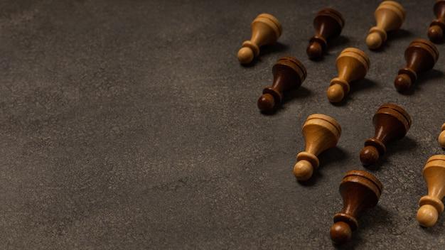 Chess pawns on dark background