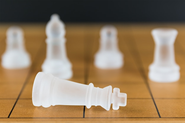 Chess piece on a wooden chessboard