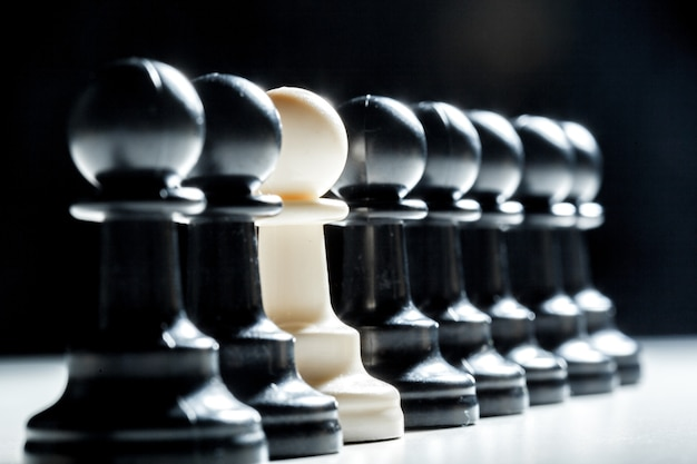Chess pieces on a black color