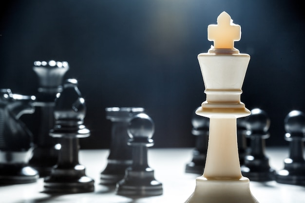 Chess pieces on a black surface