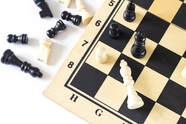 Chess pieces on chess board game top view. business, leadership and success strategy concept