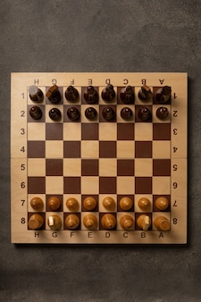 Chess pieces on a chessboard on a dark background