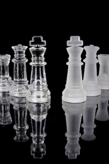 Chess pieces isolated on black background. beautiful reflection composition