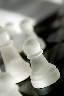 Chess pieces lying on chess board, close-up