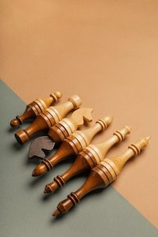 Chess pieces in a row on a flat background top view