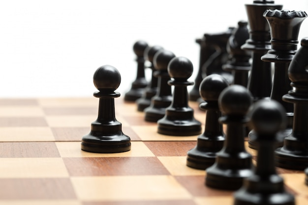 Chess pieces set on a chessboard