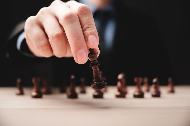 Chess strategy for business leadership and team in success concept, game king leader competition with teamwork power challenge, pawn piece playing on board, victory intelligence of chessboard