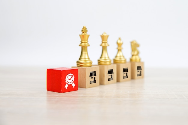 Chess team standing on wooden block stack with franchises business store icon.