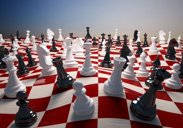 Шахматы белые и черные на большом развевающемся шахматном поле