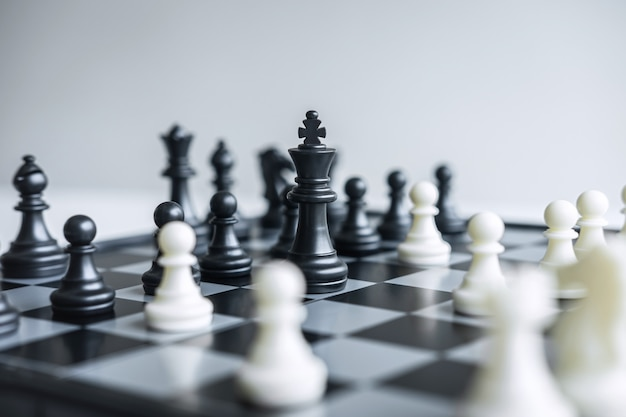 Chessboard and pawns on a table