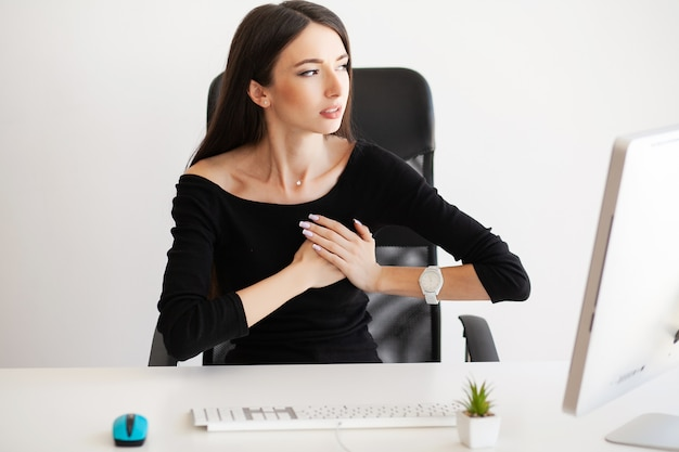 Chest pain. woman having panic attack at workplace