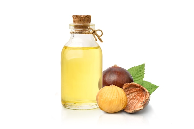 Chestnut oil with seed and leaves isolated on white background.