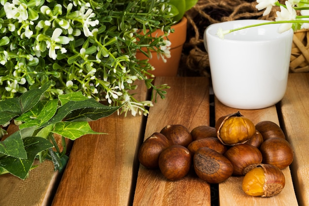 Chestnuts autumn food on wooden table