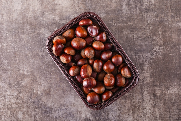 Chestnuts in brown basket top view