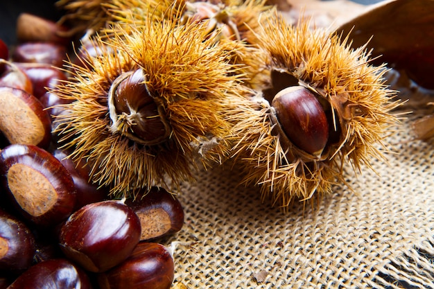Chestnuts on an old board.