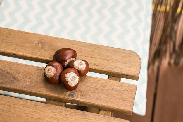 Chestnuts on a wooden surface