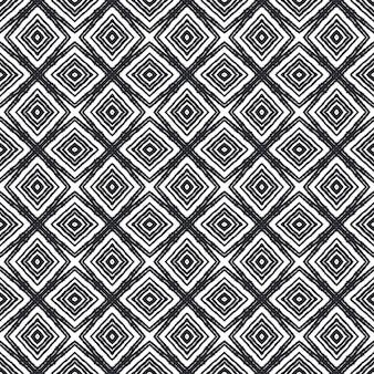 シェブロンストライプのデザイン。黒の対称的な万華鏡の背景。テキスタイル対応の繊細なプリント、水着生地、壁紙、ラッピング。幾何学的なシェブロンストライプパターン。