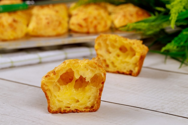 Chewy cheese bread called chipa on wooden table.