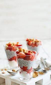 Chia pudding strawberry parfait with greek yogurt and nuts