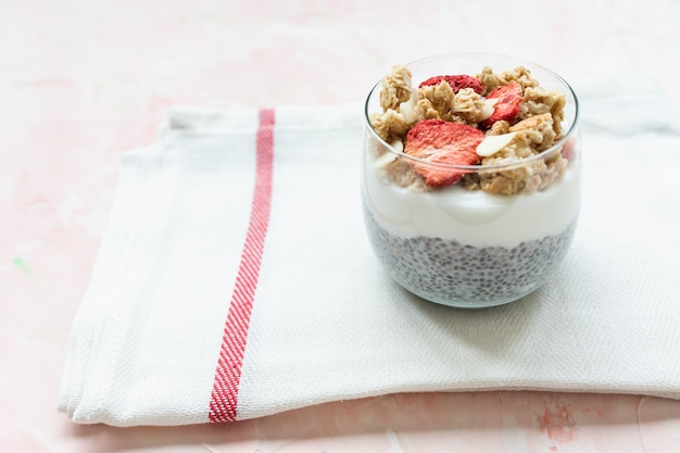 Chia pudding with almond milk, yogurt, and dried strawberries