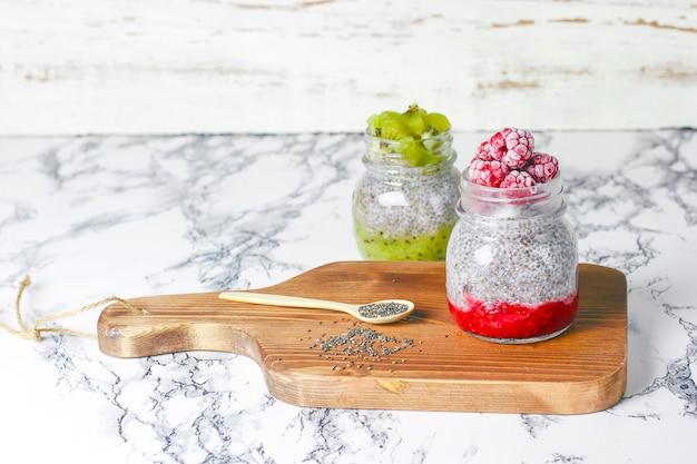 Chia pudding with berries,  raspberry sauce, kiwi sauce