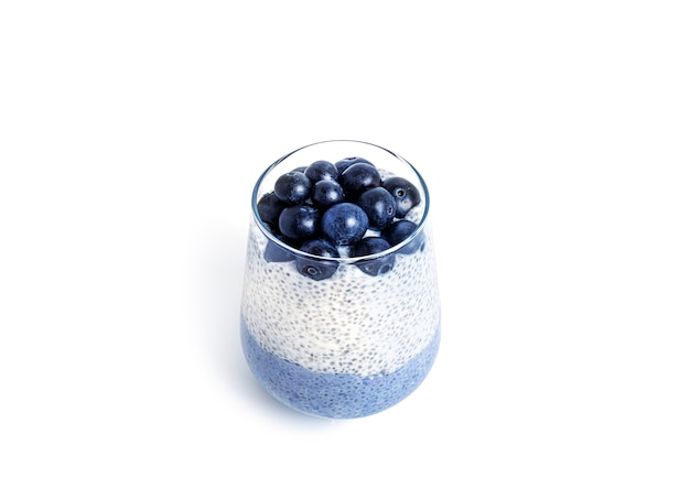 Chia pudding with blueberriesi isolated on a white background. multilayer healthy dessert. blue chia mousse. high quality photo