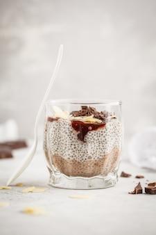 Chia pudding with chocolate, almonds and berry jam. raw vegan dessert.
