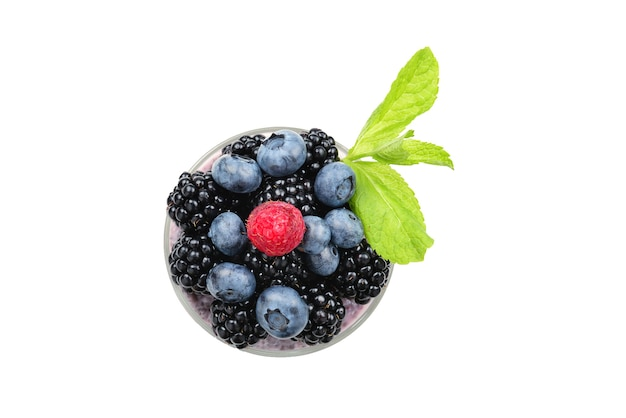 Chia pudding with mint, blueberry, blackberry on a white background. space for text or design.