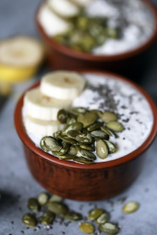 Chia pudding with pumpkin seeds and banana. healthy breakfast or snack. keto diet. keto dessert. sugar free dessert