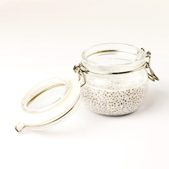 Chia seed milk pudding in glass jar. close up. selective soft focus.  text copy space.