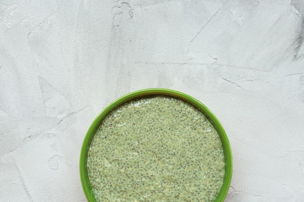 Chia seed pudding with green matcha tea in bowl