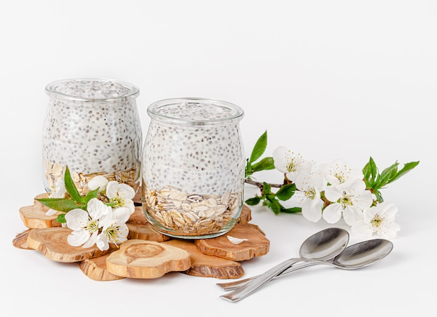 Chia seed pudding with yogurt and oats decorated with flowers. superfood concept. copy space