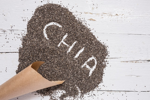 Chia seed on wooden board
