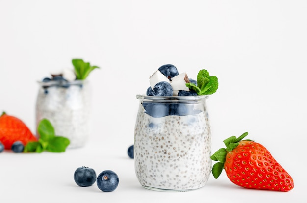 Chia seed yogurt pudding with berries, coconut and mint. superfoods concept