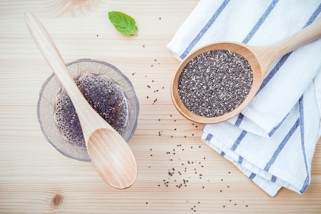 Chia seeds  for diet food ingredients setup on wooden background.