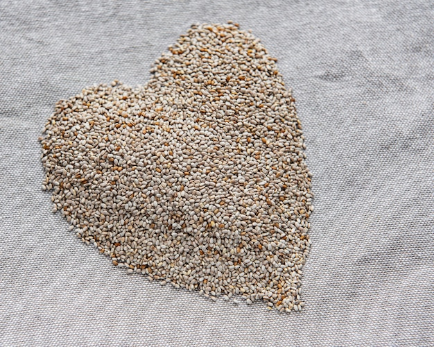 Chia seeds on a grey textile background.