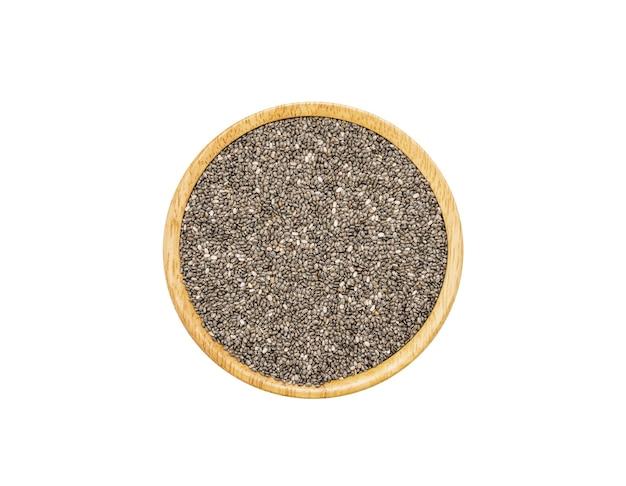 白い表面に分離された茶色の木のボウルにチアシード