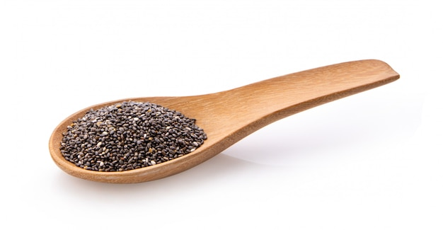 Chia seeds in wood spoon isolated with white background.