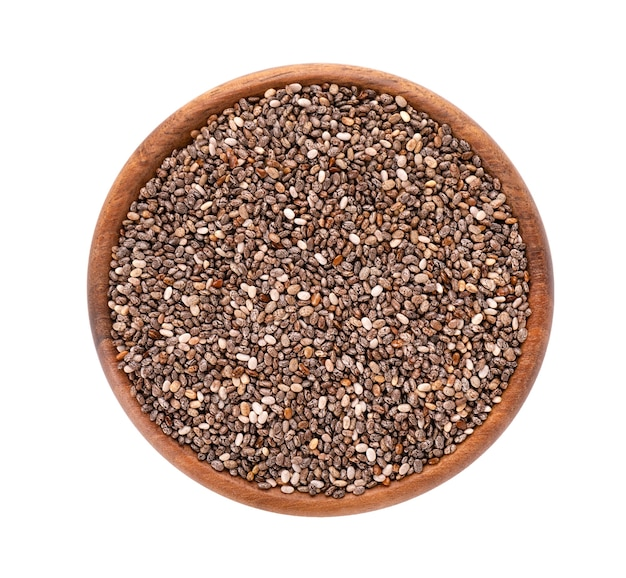 Chia seeds in wooden bowl, isolated on white background.