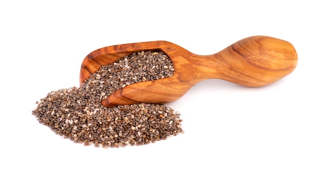 Chia seeds in wooden scoop, isolated on white background.