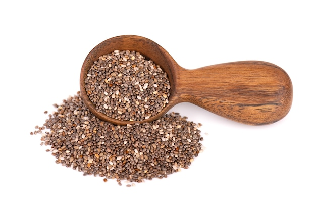 Chia seeds in wooden spoon, isolated on white background.
