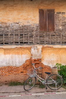 [chiang khan] bicycle and old house in chiang khan thailand